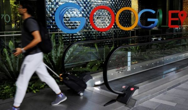 file-photo-man-passes-google-signage-outside-their-office-singapore